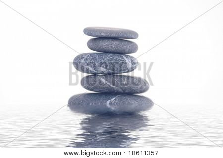 Cairn of balanced stones on water