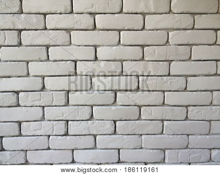 Brick block wall background in living room at home white wall in house restaurant or cafe white big brick block wall wallpaper in cafe on horizontal side architect interior design