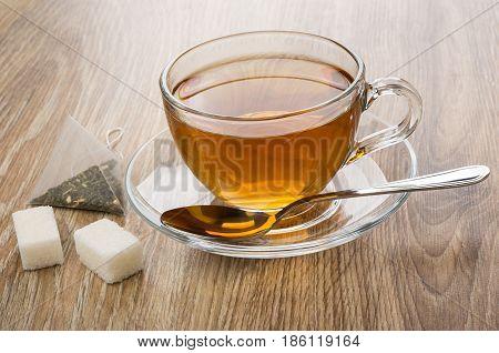 Tea In Cup With Saucer, Tea Bag And Lumpy Sugar