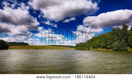 beautiful shoot of sky over the pond. Dramatic blue sky