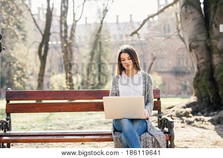 Young Woman With A Laptop On A Park Bench Sunny Day