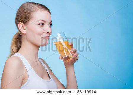 Woman Drinking Orange Flavored Drink Or Juice