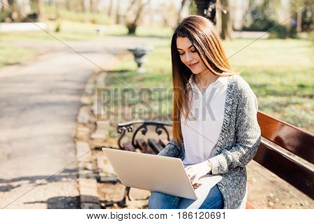 Girl Resting And Relaxing In The Park And Laptop In Sunny Day
