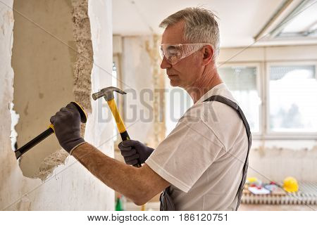 Worker Builder Demolish Wall With Tool