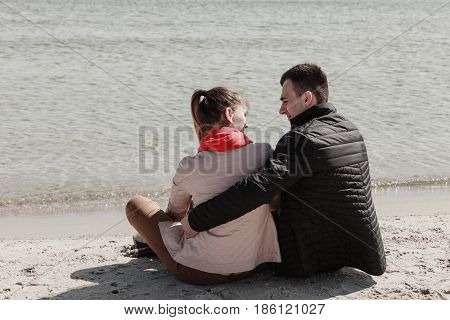 Romance beautiful relantionship concept. Happy couple having date on beach near sea.