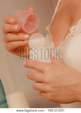 Woman Holds Stick Deodorant Cosmetic In Hands