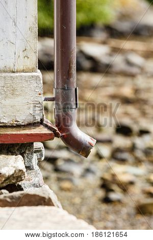 Thin Drainpipe On Cottage Wall, Rocks Background