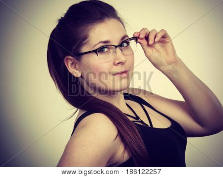Portrait of happy positive business woman or student girl wearing eyeglasses enjoying her work college.