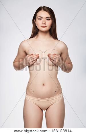 Surgery dotted line on body with marker breast