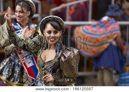 ORURO, BOLIVIA - FEBRUARY 26, 2017: Caporales dancer in ornate costumes performing as they parade through the mining city of Oruro on the Altiplano of Bolivia during the annual carnival.