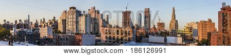 NEW YORK USA - OCT 20 2015: skyline of New York in sunset seen from Brooklyn. Brooklyn is the most populous of New York Citys five boroughs with a Census-estimated 26 Mio people.