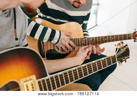 Learning to play the guitar. Music education and extracurricular lessons.