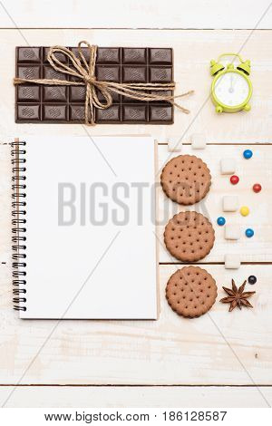 Composition Of Sweets, Green Alarm Clock And Copybook