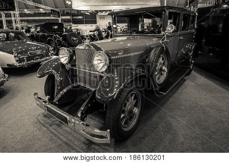 STUTTGART GERMANY - MARCH 02 2017: Luxury car Mercedes-Benz 300 Typ 12/55 PS 1926. Stylization. Sepia toning. Europe's greatest classic car exhibition