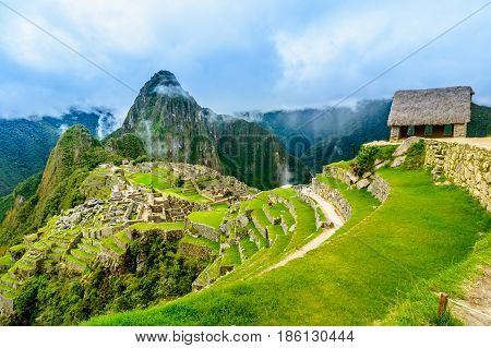 Overview of Machu Picchu, Guard house, agriculture terraces, Wayna Picchu and surrounding mountains in the background