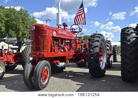 YANKTON, SOUTH DAKOTA, August 19, 2106: A Restored  Farmall  Suoer M bearing the American flag is displayed at the annual Riverboat Days celebrated the third weekend of August in Yankton, South Dakota.