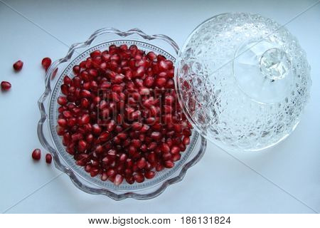 Red Pomegranate seeds in the crystal cut glass