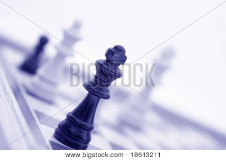 Chess pieces on board, in blue tone