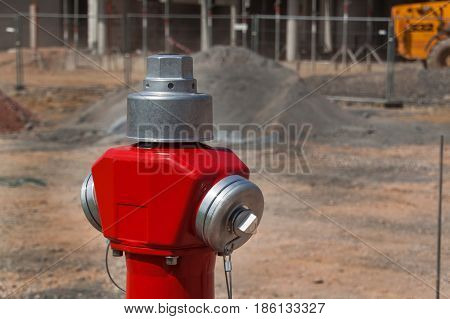 New fire hydrant on building site. Street construction. Fire safety