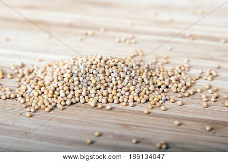 mushtard seeds on wooden background, copy space