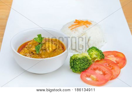 chicken tikka masala served with rice and vegetables