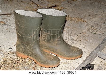 Old dirty rubber galoshes after a day's work