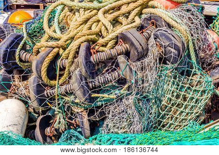 Old Faded Rope Lying On The Shore In A Fishing Port, Industry Equipment