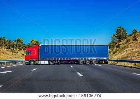 Road closed by big truck standing across. Road accident concept.