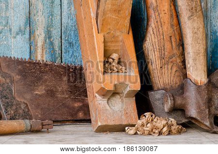 Axes, Planer Shavings And Saw The Old Blue Wooden Background. Close Up