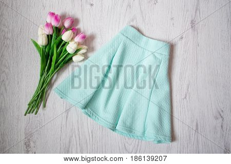Skirt Menthol Color, Pink Tulips. Fashionable Concept, Top View