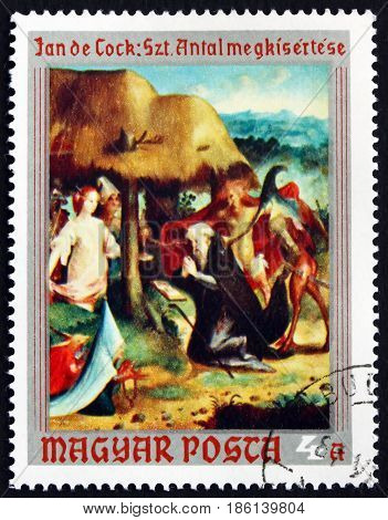 HUNGARY - CIRCA 1970: a stamp printed in Hungary shows Temptation of St. Anthony the Hermit Painting by Jan Claudius de Cock Flemish Painter circa 1970