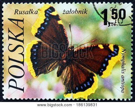 POLAND - CIRCA 1977: a stamp printed in the Poland shows the Mourning Cloak Nymphalis Antiopa Butterfly circa 1977
