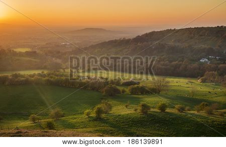 Scenic Warm Orange Sunset Sky over Gloucester Valley in England