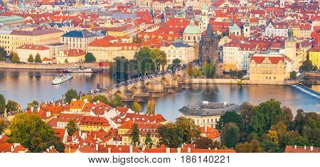 Aerial view of cityscape with Charles Bridge over Vltava River and Old Town of Prague from Petrin Hill Observation Tower in the sunny evening, Prague capital city of Czech Republic, Europe. UNESCO World Heritage Site.