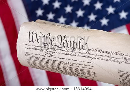 United States constitution with american flag in background