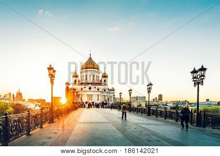 Evening mood of a sunset on the Patriarchal bridge in Moscow near Christ the Savior Cathedral. Russia.