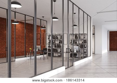Side view of an office room with glass and brick walls concrete floor and two bookcases standing near a computer desk. 3d rendering