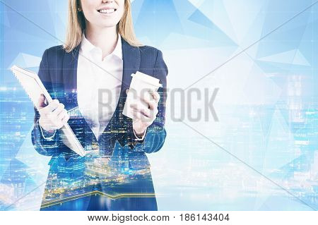 Portrait of an unrecognizable businesswoman with a coffee to go and a notebook standing against a blue city panorama. Toned image double exposure mock up
