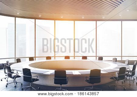Conference room interior with a round table black office chairs near it and a panoramic window. 3d rendering toned image