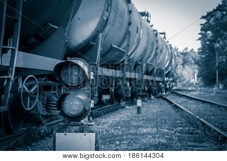 Railroad traffic light and freight train on behind