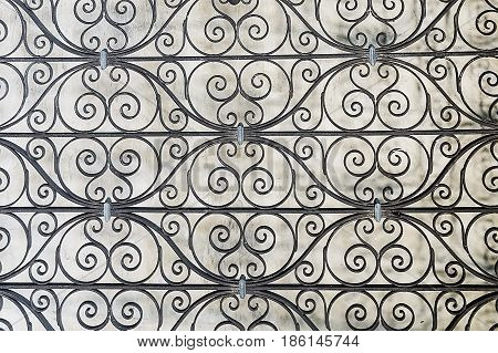 Old black iron wrought grating close up
