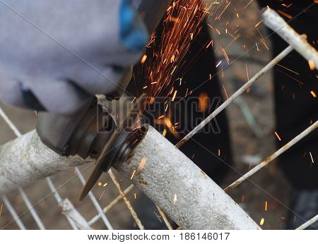 metal cutting saw working with grinder circular tool blade sparks