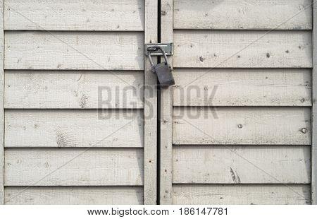 lock door wood planks padlock metal beige