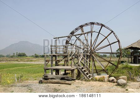 Big Wooden Turbine Baler Water Wheel At Thai Dam Cultural Village In Chiang Khan At Loei, Thailand