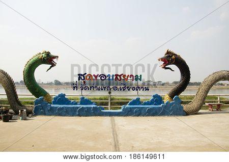 Green And Black Naga Statue For People Take Photo At Mae Khong Riverside At Thakhek Temple