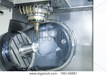 The 5 axis CNC machine while cutting sample aerospace part. Turbine blade cutting by using 5 axis CNC machine