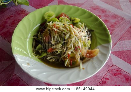 Thai Cuisine Som Tum Or Thai Food Fruit Spicy Green Papaya Salad With Pickled Fish And Tomato