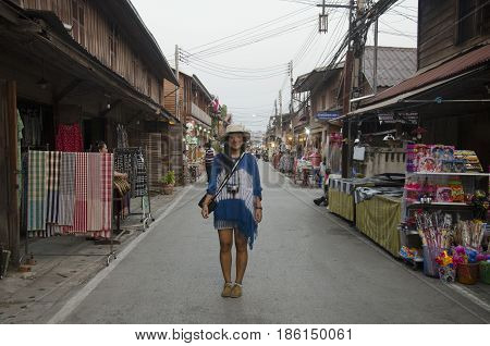 Asian Thai Woman Traveler Visit And Posing For Take Photo On The Road In Small Alley At Street Night