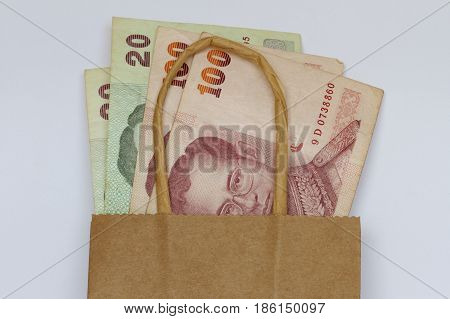 Thai money in a brown hessian bag.