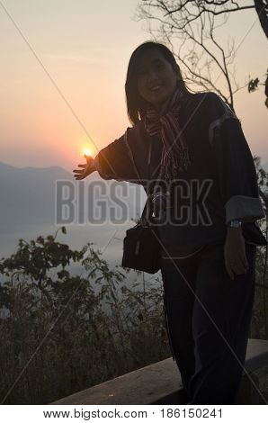 Asain Thai Women Travelers Visit And Posing With Sun At Viewpoint Of Phu Tok Mountain